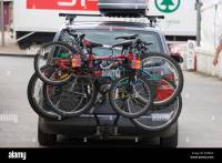 Bicycles on a bike rack on the back of a car Stock Photo ...