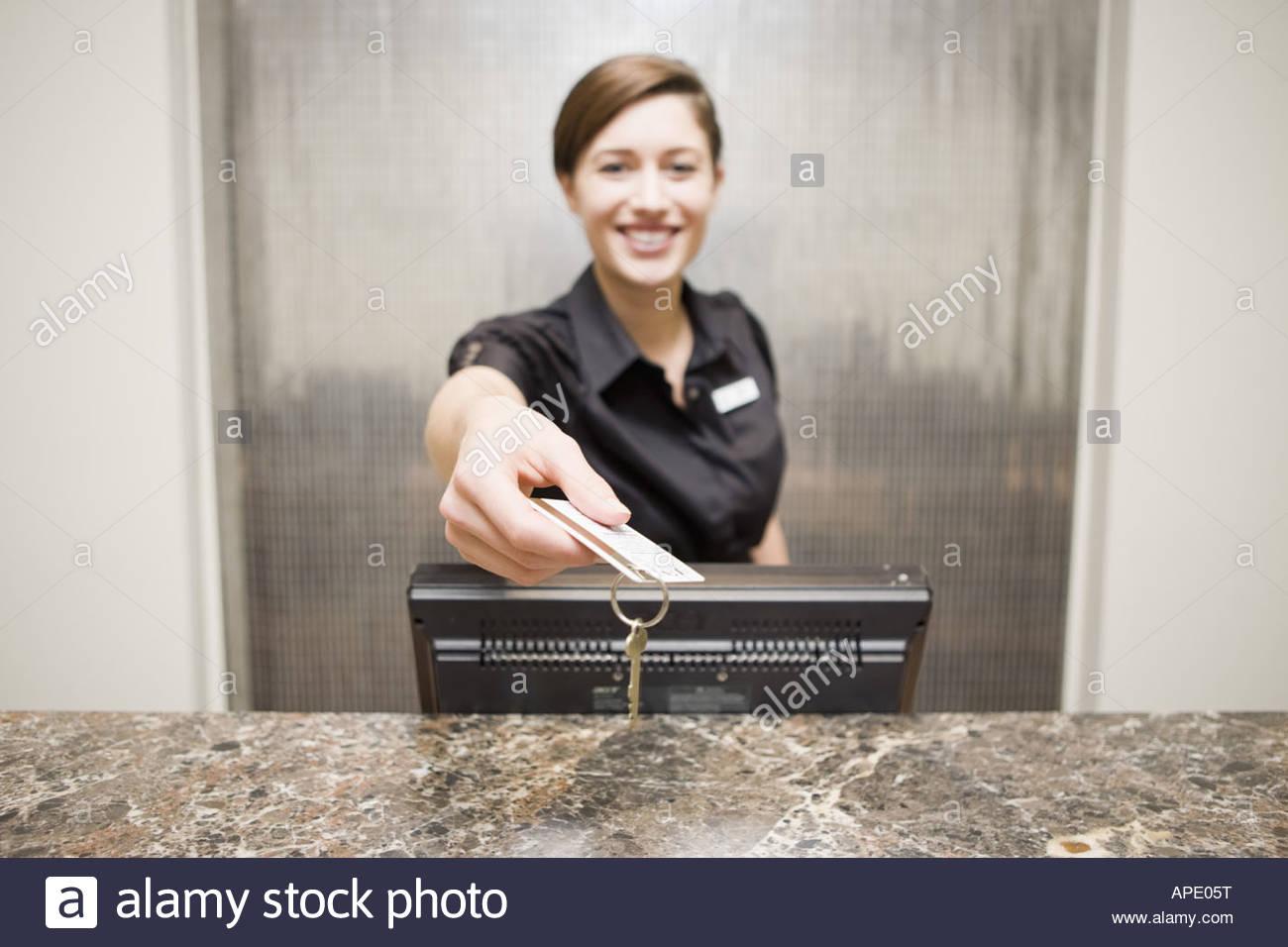 Female hotel front desk clerk handing keycard Stock Photo Royalty Free Image 15761603  Alamy