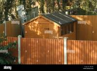 Back garden timber fence panels with concrete posts and ...