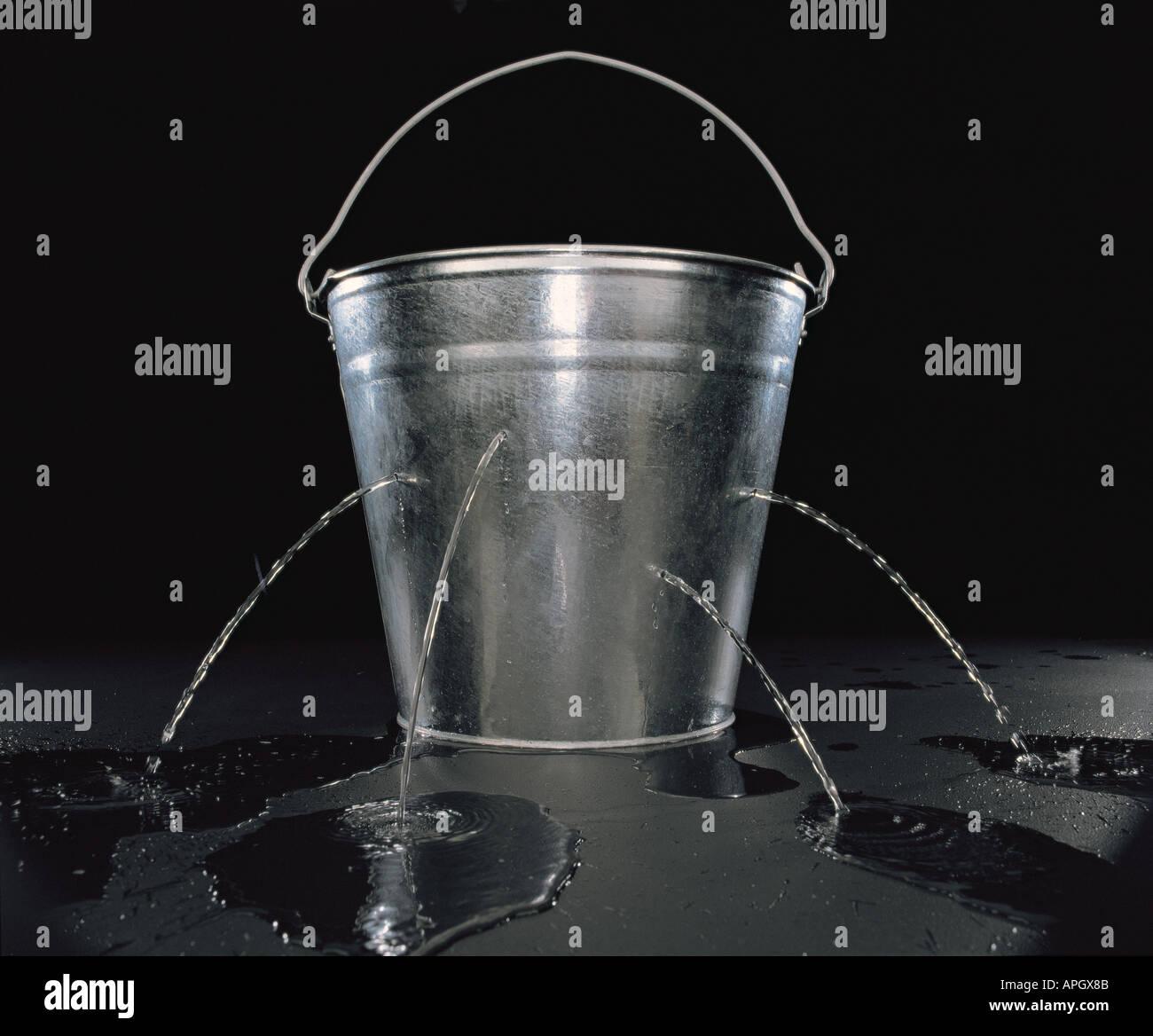 leaking bucket of water Stock Photo 5155466  Alamy