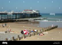 Uk Norfolk Cromer People Beach With Pier And