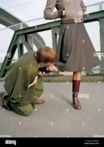 Kneeling Man Kissing Foot Of Woman Stock Royalty