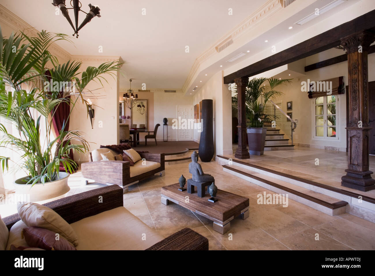 modern orange chair patio chaise lounge spanish villa living room at dusk stock photo: 15873245 - alamy