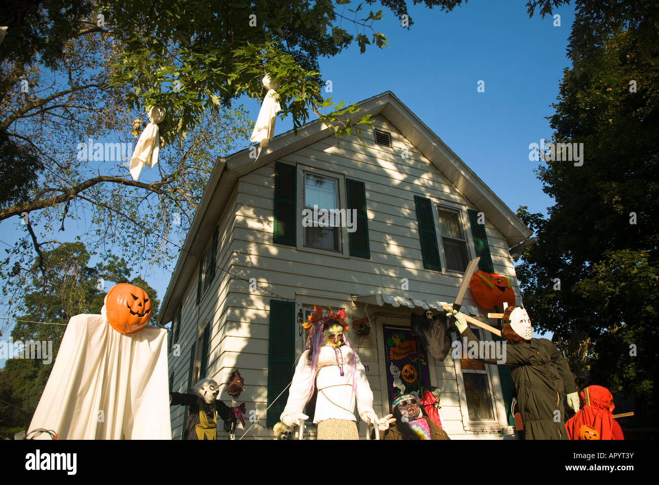 Illinois Dixon Ghoulish Halloween Decorations In Front Yard Of House  Pumpkin Head Executioner Scary People Standing