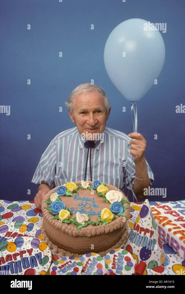 90 Year Man Holding Balloon With Birthday Cake Stock