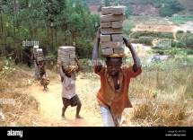 Rwandan Genocide Orphans Survive Working Carrying