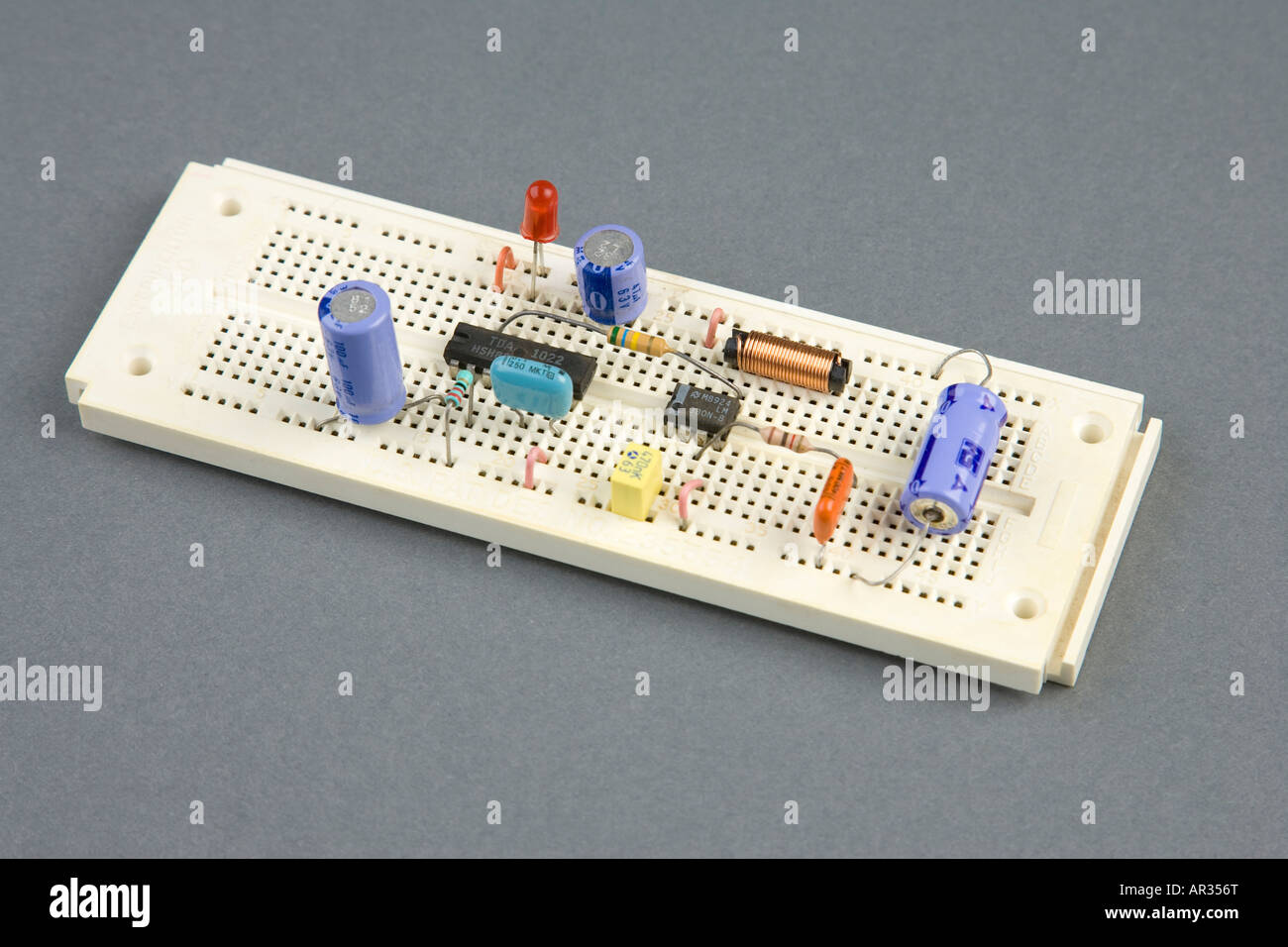 Testing Prototype Of Electrical Circuit On Breadboard With Voltmeter