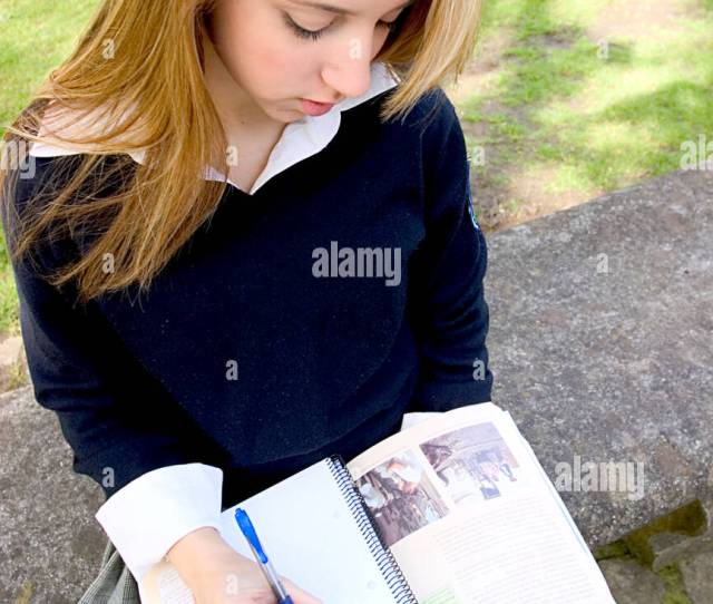 Teenage Blonde Schoolgirl Studying In The Park And Looking Desperate