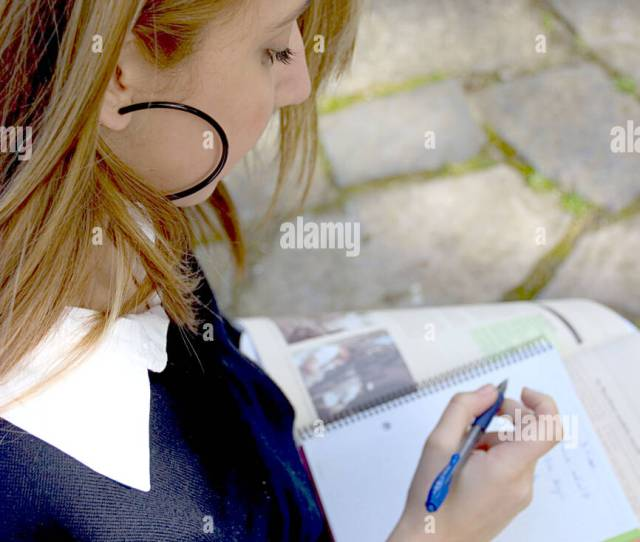 Teenage Blonde Schoolgirl Studying In The Park