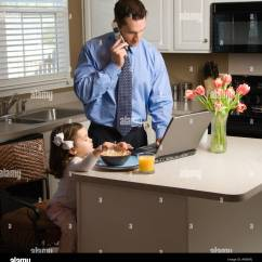 Kitchen Phone Backsplash Tile Designs Busy Father Stock Photos Caucasian In Suit Talking On Cellphone And Using Laptop Computer With Daughter Eating Breakfast