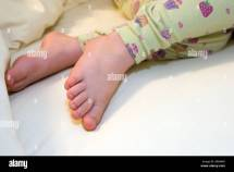 Young Girl Age 4 Asleep In Bed Bare Feet Covered With