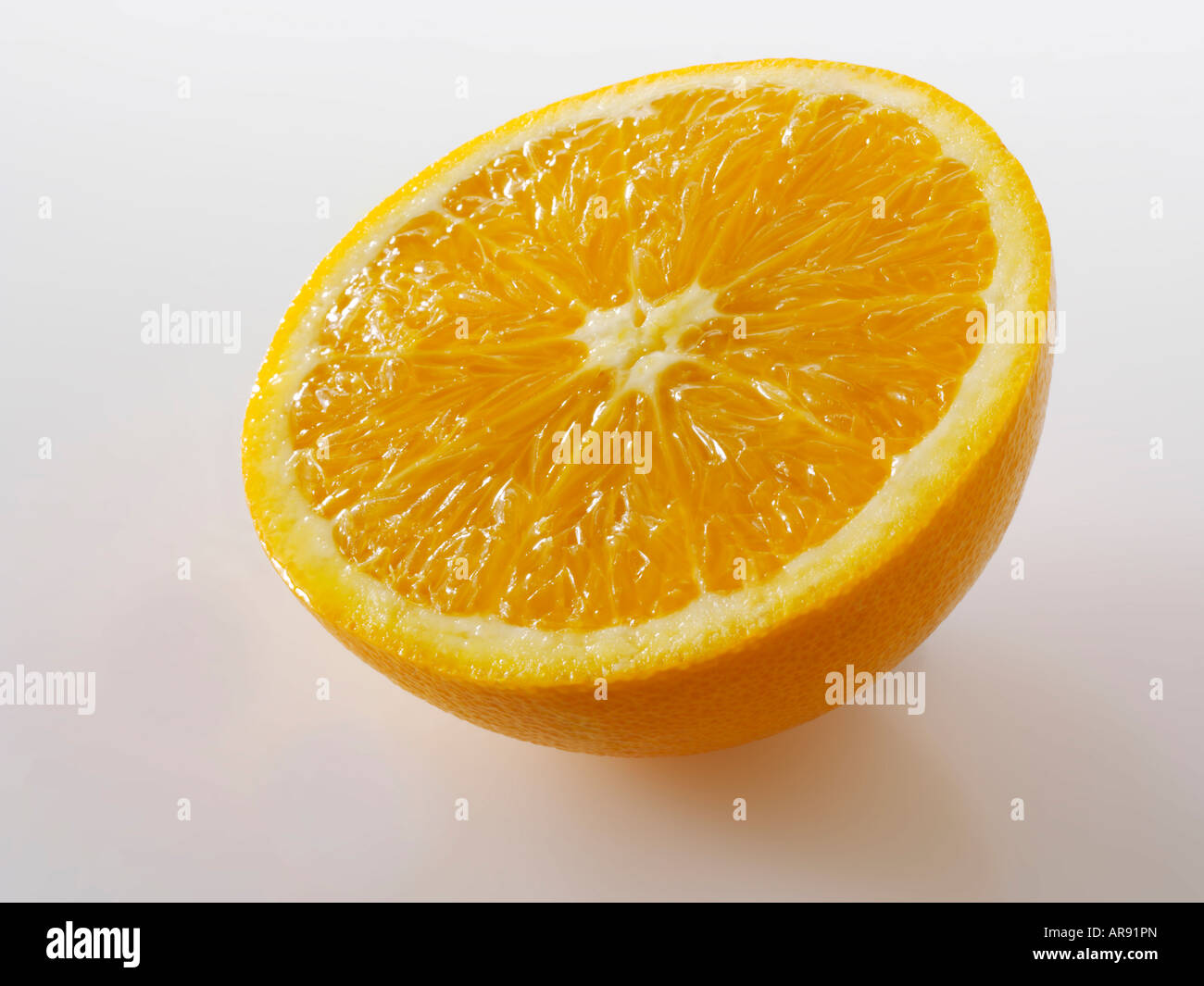 Half An Orange Slice On A White Background As A Cut Out