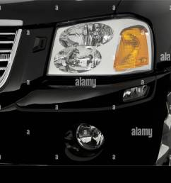 2006 gmc envoy xl slt in black headlight stock image [ 1300 x 956 Pixel ]
