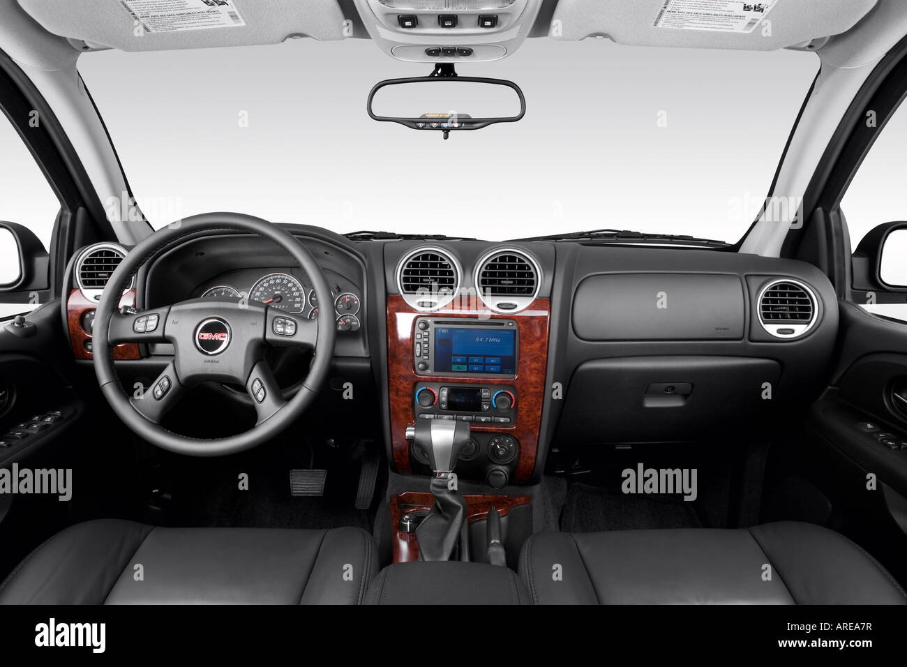 hight resolution of 2006 gmc envoy xl slt in black dashboard center console gear shifter view