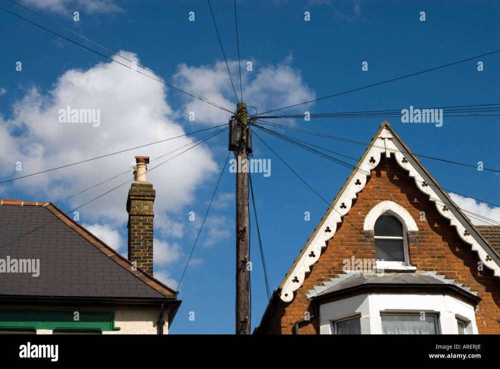 medium resolution of telephone wires attached to wooden post in residential street london england uk