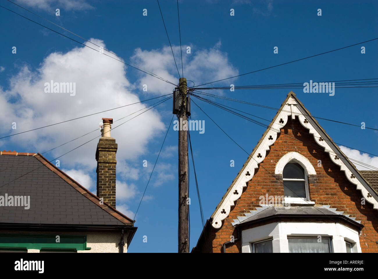 hight resolution of telephone wires attached to wooden post in residential street london england uk