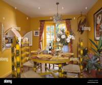Painted yellow chairs and table in bright yellow dining ...