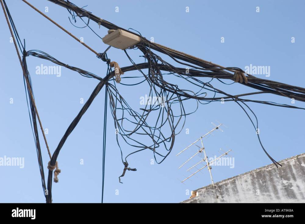 medium resolution of mess of electrical cables and telephone wires