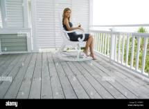 Woman in Rocking Chair On Porch