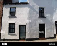 curved bent white house black windows doors Stock Photo ...