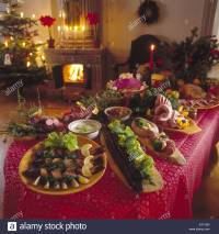 Christmas food decorations on dinner table Stock Photo ...