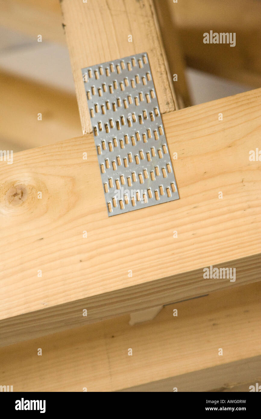 gangnail plate holding timber beams together in a timber