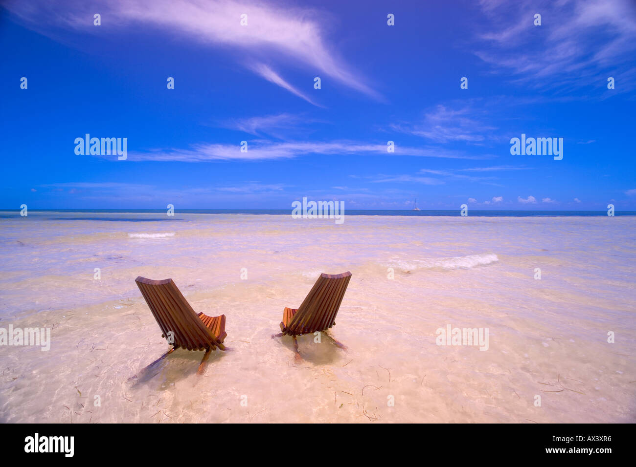 key west chairs chair covers wedding diy two beach in shallow water florida usa stock