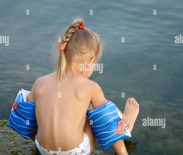 Little Girl On A Sea Shore Stock Image