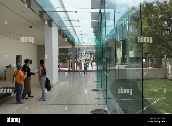 Glass Wall And People In Interior Of Art