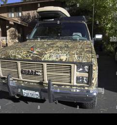 gmc sierra classic 2500 suburban 4wd 1987 on a 3 4 ton chassis camouflaged with camo extreme max 4 hd [ 1300 x 956 Pixel ]
