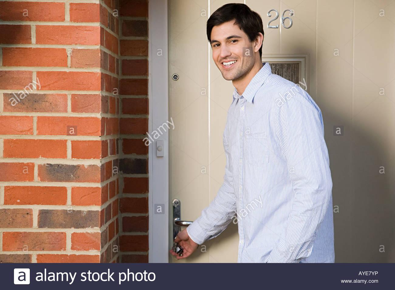 Man opening front door Stock Photo, Royalty Free Image