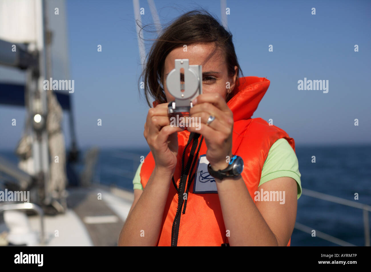 Woman Using A Compass Stock Photo