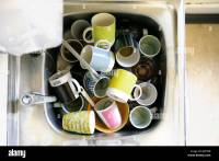 Office life dirty cups in sink Stock Photo, Royalty Free