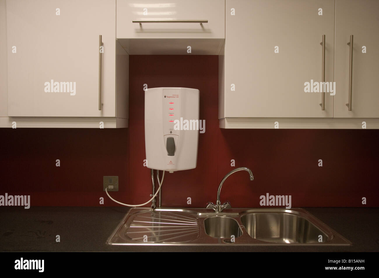 kitchen draining board how to care for granite countertops an electric water heater above a sink. this is in ...