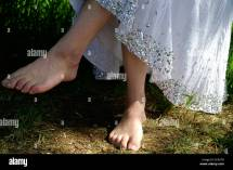 Bare Feet Of Young Woman Teen Girl And White Skirt Stock