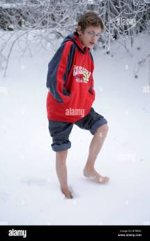Young Boy Walking Barefoot Snow Stock