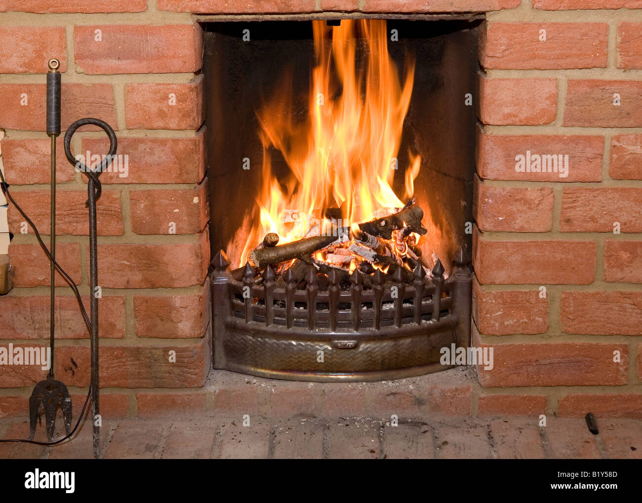 Open Fire Burning In A Brick Fireplace Stock Photo