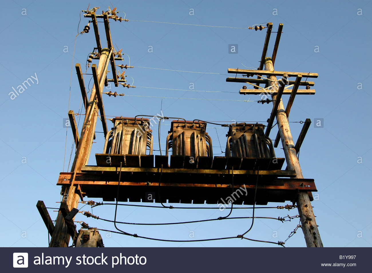 hight resolution of an old fashioned electrical transformer from the 1950s mounted on a platform between two wooden masts in vancouver canada