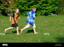 Young Barefoot Boy Running