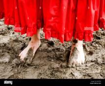 Women Walking Barefoot in Mud