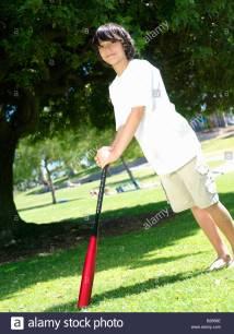 Boy 10-12 With Baseball Bat Outdoors Portrait Stock
