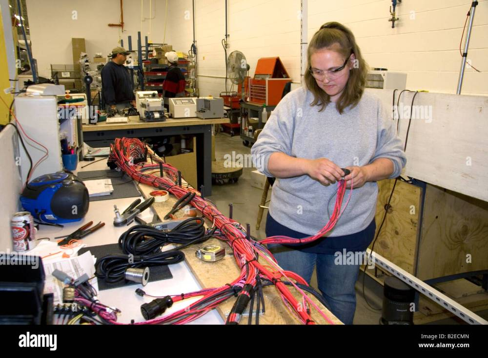 medium resolution of female worker with wiring harness assembly at spartan motors truck chassis manufacturing in charlotte michigan