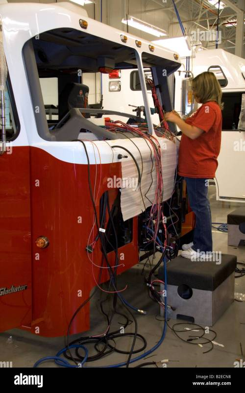 small resolution of female worker installing wiring into a newly manufactured fire truck chassis at spartan motors in charlotte