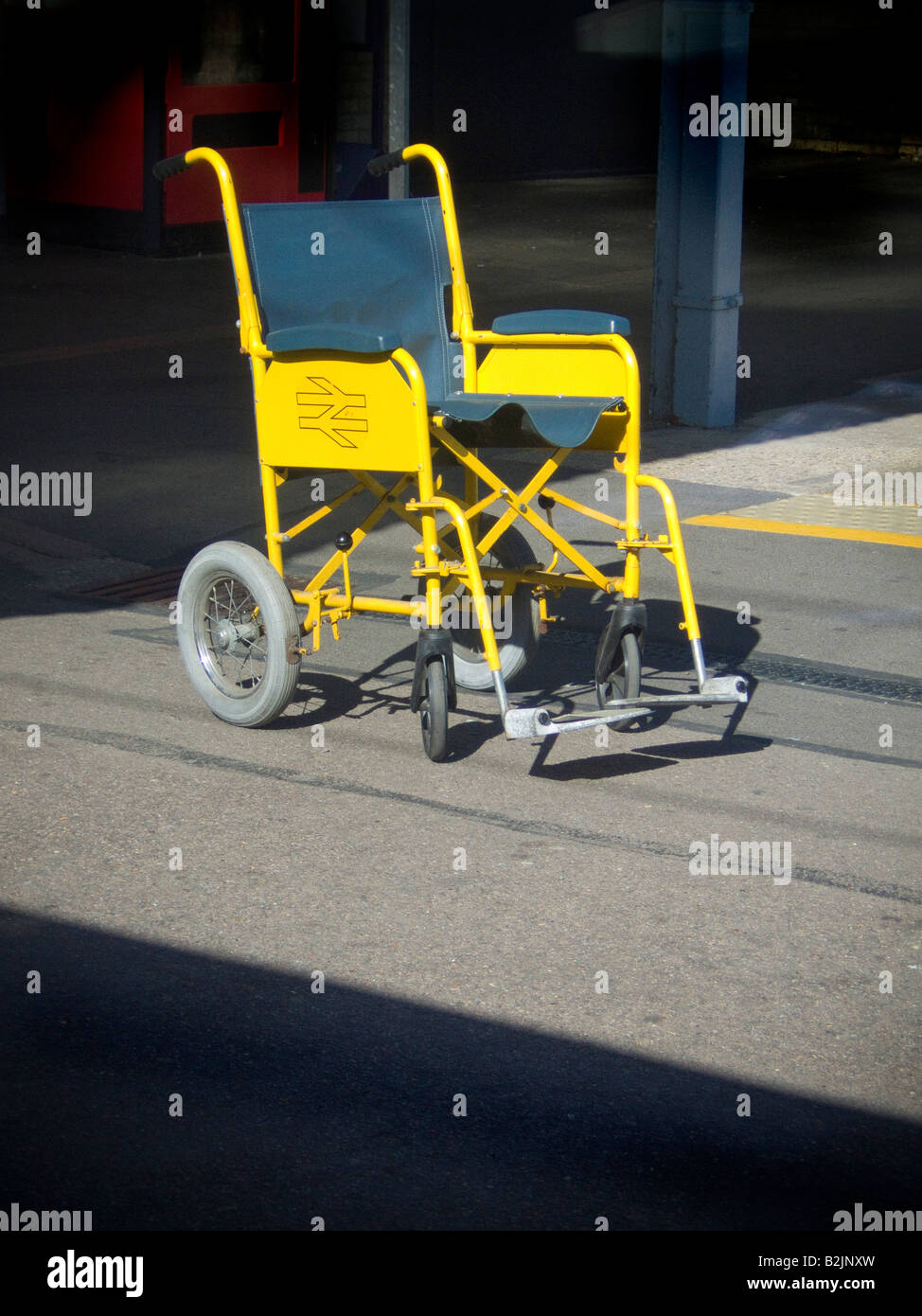 yellow wheelchair cream crushed velvet chair covers stock photos images alamy a sitting in isolation awaiting ride disability concept image