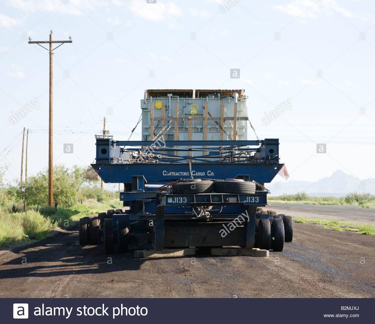 hight resolution of dual lane transporter heavy hauler 32 axles 128 tires heavy transformer hauling wide load oversize load