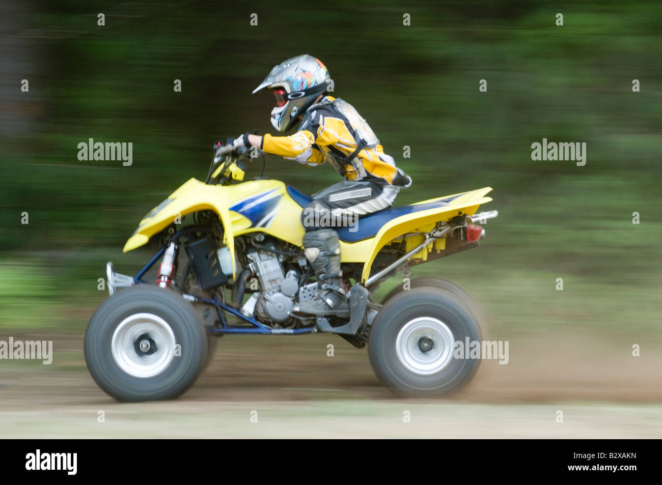 hight resolution of young boy riding an atv four wheeler vehicle