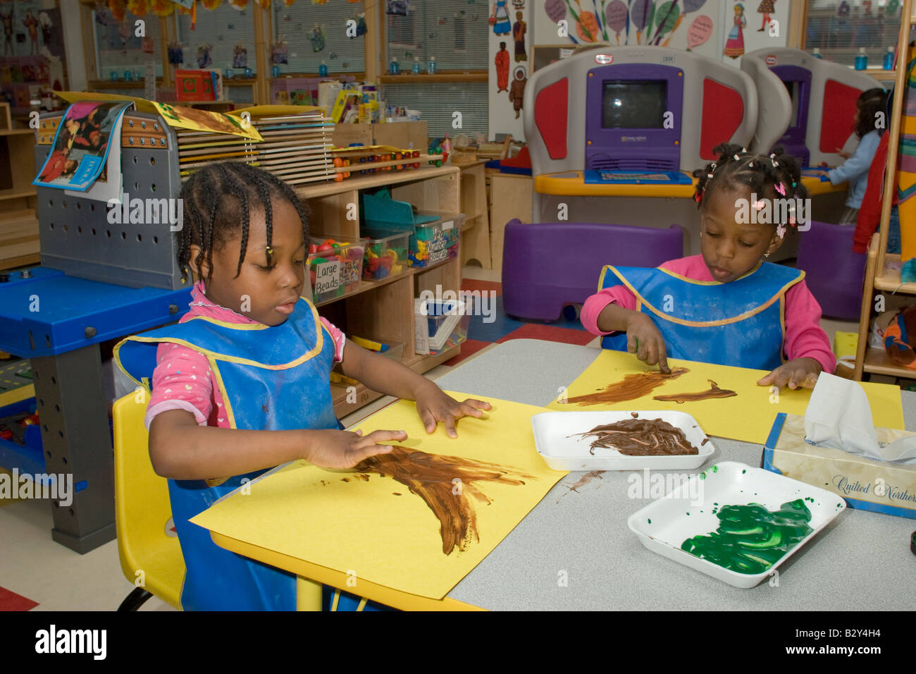 Two 4 Year Old African American Girls Finger Painting In