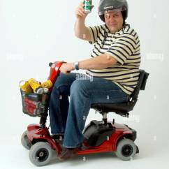 Wheelchair Man Massage Sofa Chair Disabled In Motorised With Cans Of Lager Stock Photo