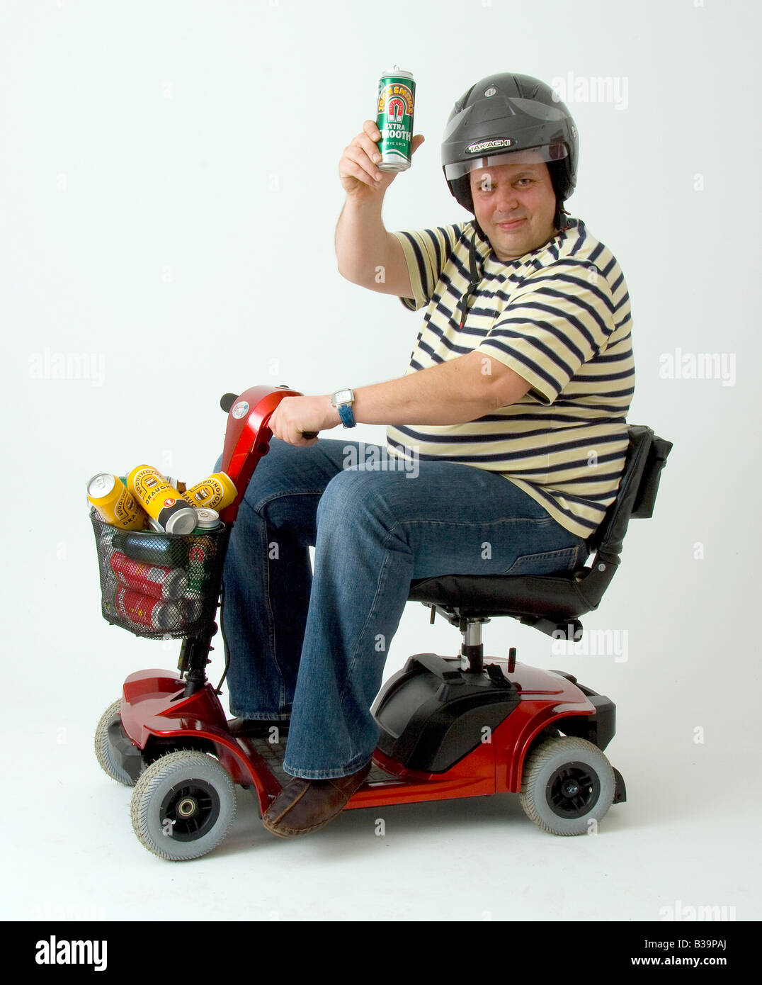 wheelchair man bedroom chair with table disabled in motorised cans of lager stock photo