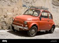 Old red Fiat 500 car with roof rack parked in Lecce City ...